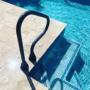 Saftron swimming pool grab rail installed poolside